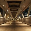Pedestrian Bridge in the city of Hong Kong at night - Photo