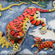 Stock Photo: Tiger family on wall of taoist temple in Hong Kong