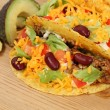 Mexican food - tacos filled with minced meat, cheese and beans — Stock Photo