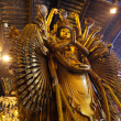 Thousand arms god statue in Longhua temple, Shanghai China - Stock Photo