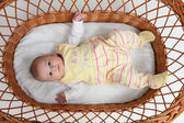 Baby in bassinet — Stock Photo