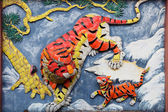 Tiger family on the wall of taoist temple in Hong Kong — Stock Photo