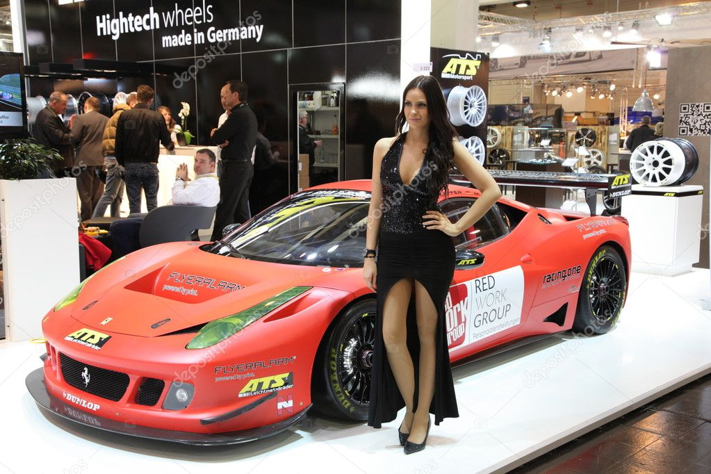 ESSEN - NOV 29: Model in front of a Ferrari shown at the Essen Motor Show in Essen, Germany, on November 29, 2011 — Stock Photo #7945669