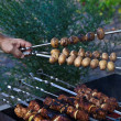 Royalty-Free Stock Photo: Shish kebab in process of cooking on open fire outdoors