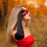Beautiful woman in red dress in autumn — Stock Photo