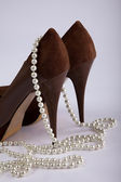 High Heel Shoe with pearl necklace — Stock Photo