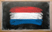 Flag of Netherlands on blackboard painted with chalk — Stock Photo
