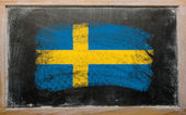 Flag of Sweden on blackboard painted with chalk — Stok fotoğraf