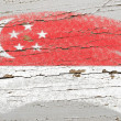 Flag of Singapore on grunge wooden texture painted with chalk — Stock fotografie