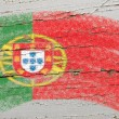 Stock Photo: Flag of Portugal on grunge wooden texture painted with chalk