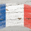 Flag of France on grunge wooden texture painted with chalk — Stock fotografie