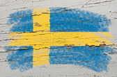 Flag of Sweden on grunge wooden texture painted with chalk — Stock Photo