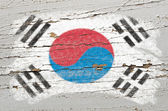 Flag of South Korea on grunge wooden texture painted with chalk — Stock Photo