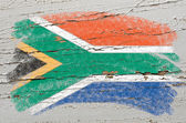 Flag of South Africa on grunge wooden texture painted with chalk — Stock Photo