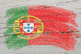 Flag of Portugal on grunge wooden texture painted with chalk — Stok fotoğraf