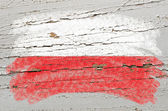 Flag of poland on grunge wooden texture painted with chalk — Foto Stock
