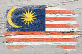 Flag of Malaysia on grunge wooden texture painted with chalk — Stock fotografie