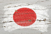 Flag of Japan on grunge wooden texture painted with chalk — Stockfoto