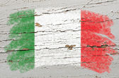 Flag of Italy on grunge wooden texture painted with chalk — Stok fotoğraf