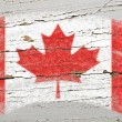 Flag of Canada on grunge wooden texture painted with chalk — Foto de Stock