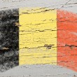 Flag of Belgium on grunge wooden texture painted with chalk — Stock Photo