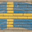Flag of Sweden on grunge brick wall painted with chalk — ストック写真