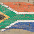 Flag of South Africa on grunge brick wall painted with chalk — Stock Photo