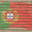 Flag of Portugal on grunge brick wall painted with chalk - Stock Photo