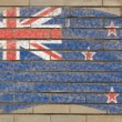 Flag of New Zealand on grunge brick wall painted with chalk — Stockfoto #6850688
