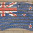 Flag of New Zealand on grunge brick wall painted with chalk — Stock fotografie #6850688