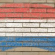 Flag of Netherlands on grunge brick wall painted with chalk — 图库照片