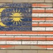 Flag of malaysia on grunge brick wall painted with chalk — Stok fotoğraf