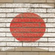 Flag of Japan on grunge brick wall painted with chalk — ストック写真