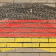 Flag of Germany on grunge brick wall painted with chalk — Stock fotografie