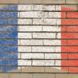 Flag of France on grunge brick wall painted with chalk — Stock fotografie