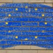 Flag of EU on grunge brick wall painted with chalk — Stockfoto