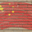 Royalty-Free Stock Photo: Flag of China on grunge brick wall painted with chalk