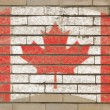 Flag of Canada on grunge brick wall painted with chalk — Stock Photo