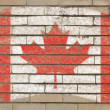 Royalty-Free Stock Photo: Flag of Canada on grunge brick wall painted with chalk