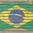 Flag of Brazil on grunge brick wall painted with chalk — Stock fotografie