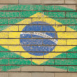 Flag of Brazil on grunge brick wall painted with chalk — 图库照片