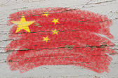 Flag of China on grunge wooden texture painted with chalk — Stock Photo