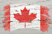 Flag of Canada on grunge wooden texture painted with chalk — Stock Photo