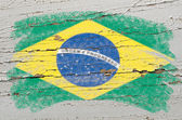 Flag of Brazil on grunge wooden texture painted with chalk — Foto de Stock