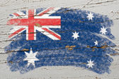 Flag of Australia on grunge wooden texture painted with chalk — Stock Photo