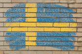 Flag of Sweden on grunge brick wall painted with chalk — Stock Photo