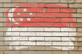 Flag of Singapore on grunge brick wall painted with chalk — Stock Photo