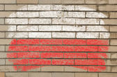 Flag of Poland on grunge brick wall painted with chalk — Stock Photo