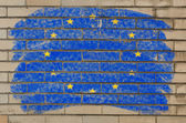 Flag of EU on grunge brick wall painted with chalk — Stock Photo