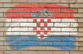Flag of Croatia on grunge brick wall painted with chalk — Foto Stock